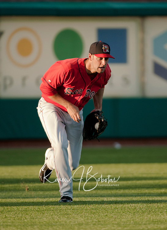 Portland Sea Dogs left fielder Alex Hassan makes the play during Saturday's game with the New Hampshire Fisher Cats.  (Karen Bobotas/for the Concord Monitor)
