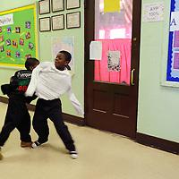 JaJuan and Deshazio play in the hallway.