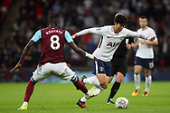 Son Heung-min of Tottenham Hotspur (r) goes past Cheikhou Kouyate of West Ham United (l). EFL Carabao Cup, 4th round match, Tottenham Hotspur v West Ham United at Wembley Stadium in London on Wednesday 25th October 2017.<br /> pic by Steffan Bowen, Andrew Orchard sports photography.