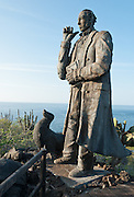 """Tourism sites near the town of Puerto Baquerizo Moreno include a statue of Charles Darwin, marking the original site where he first disembarked in the Galápagos Islands during the voyage of the Beagle, on 16 September 1835. Isla San Cristóbal (Chatham Island) is the easternmost island in the Galápagos archipelago, and one of the oldest geologically.  Its Spanish (and most commonly used) name """"San Cristóbal"""" comes from the Patron Saint of seafarers, """"St. Christopher."""" Its older English name of Chatham is that of William Pitt, 1st Earl of Chatham. Its highest point rises to 730 meters. The capital of the Galápagos archipelago, Puerto Baquerizo Moreno, lies at the south-western tip of the island."""