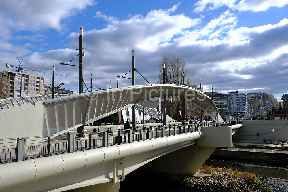The Mitrovica bridge, over the river Ibar which separates the Serbian and Albanian districts of Mitrovica, Kosovo on the 12th of December 2018, it was rebuilt with funding from the EU. Mitrovica or Kosovska Mitrovica is a city and municipality located in Kosovo. Settled on the banks of Ibar and Sitnica rivers, the city is the administrative center of the Mitrovica District.