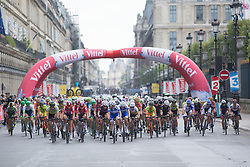 The peloton rides under the flamme rouge in the second lap of the La Course, a 89 km road race in Paris on July 24, 2016 in France.