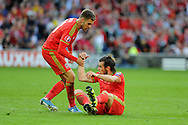 Aaron Ramsey of Wales helps Gareth Bale off the ground after Bale had missed a chance to score.  Euro 2016 qualifying match, Wales v Israel at the Cardiff city stadium in Cardiff, South Wales on Sunday 6th Sept 2015.  pic by Andrew Orchard, Andrew Orchard sports photography.