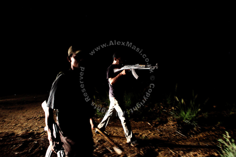 Two armed members of the AVCC, (Anti-Violence Crime Cell) a special police unit mostly involved in anti-terrorism operations and kidnap cases in the city of Karachi, are raiding a cluster of houses on the outskirts of the city on their search for a kidnap suspect during a fake ransom meet up with the criminals.