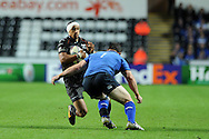 Eli Walker of the Ospreys (l) looks to go past Leinster's Cian Healy ®. Heineken cup rugby, pool 1 match, Ospreys v Leinster rugby at the Liberty stadium in Swansea on Sat 12th October 2013 pic by Andrew Orchard, Andrew Orchard sports photography,