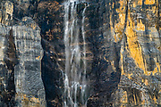 A waterfall plunges from the sheer walls of Stanley Peak, along Stanley Glacier Trail in Kootenay National Park, British Columbia, Canada.