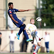 istanbulspor's Mehmet can Kasap (R) and Kasimpasa's Kalu Uche (L) during their Turkey Cup second leg soccer match istanbulspor between Kasimpasa at the Bahcelievler Stadium at istanbul Turkey on wednesday, 26 September 2012. Photo by TURKPIX