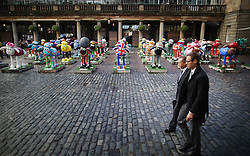 © Licensed to London News Pictures. 24/09/2015. London, UK. People walk past some of the 120 Shaun the Sheep sculptures placed in Covent Garden market ahead of their auction. The auction on the 8th October 2015 will raise funds for the  Wallace & Gromit's Children's Charity supporting children's hospitals and hospices throughout the UK.  Photo credit: Peter Macdiarmid/LNP