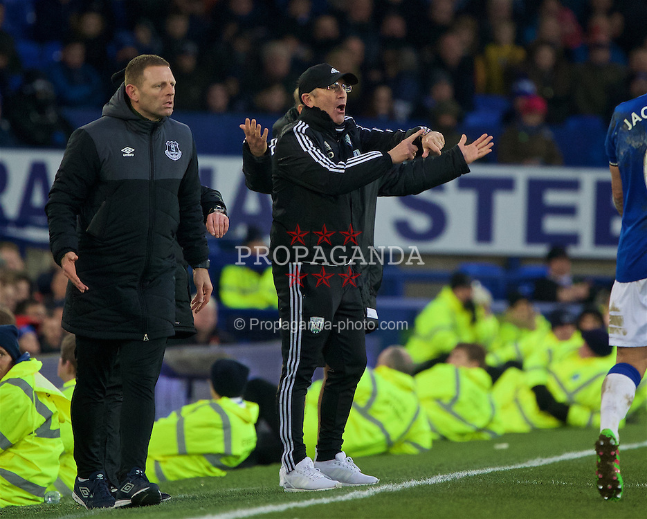 LIVERPOOL, ENGLAND - Saturday, February 13, 2016: West Bromwich Albion's head coach Tony Pulis points to his watch as five minutes of injury time are played during the Premier League match against Everton at Goodison Park. (Pic by David Rawcliffe/Propaganda)