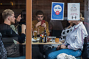Local residents and visitors enjoy subsidised Bank Holiday Monday lunches at a Japanese restaurant on the final day of the government's Eat Out To Help Out meal scheme on 31 August 2020 in Windsor, United Kingdom. Many restaurant owners have called for an extension to the scheme introduced by the Chancellor of the Exchequer to help preserve hospitality jobs during the COVID-19 pandemic.