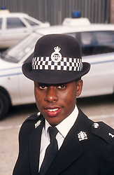 Portrait of community police officer standing in street,