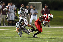 25 September 2010: Skylar Smith trips up runner Marvon Sanders.   The Missouri State Bears lost to the Illinois State Redbirds 44-41 in double overtime, meeting at Hancock Stadium on the campus of Illinois State University in Normal Illinois.