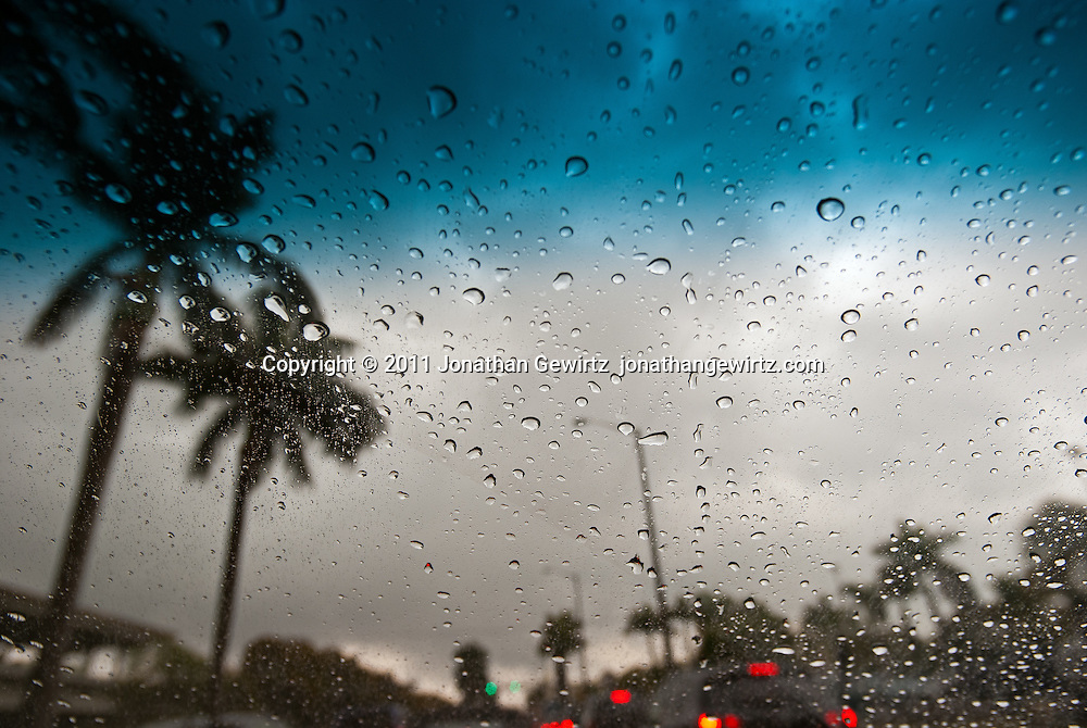 Rainy-day traffic in the tropics as seen through an automobile winshield. WATERMARKS WILL NOT APPEAR ON PRINTS OR LICENSED IMAGES.