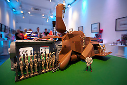 © Licensed to London News Pictures. 19/07/2012. LONDON, UK. Hasbro's new Star Wars 'Multi-Troop Transport Droid Carrier' is seen at the company's 'Christmas in July' toy launch in London today (19/07/12). The toy, featuring an extendable droid rack with 16 battle droid action figures also comes with an Obi-Wan Kenobi figurine and is set to hit the shops in time for Christmas 2012 priced at GB£149.99. Photo credit: Matt Cetti-Roberts/LNP