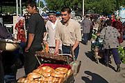 Tashkent, Uzbekistan, 12/05/2004..Traditional bread being transported at Chorsu [Chor Su] market, in central Tashkent.