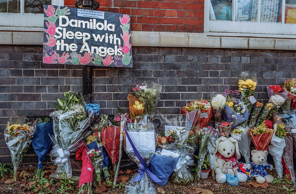 Floral tributes outside Damilola Taylor's school, Oliver Goldsmith's Primary School in Peckham, London. The young boy was murdered on his way home from school 27th November 2000.