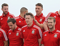 DINARD, FRANCE - Tuesday, June 7, 2016: Wales' James Chester playfully ruffles the hair of Wales goalkeeper Wayne Hennessey as players prepare for a team group photograph at the Novotel Thalasso Dinard ahead of the start of the UEFA Euro 2016 tournament. (Pic by Paul Greenwood/Propaganda)