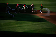 Steven St. John/Tribune..Grounds keepers at Isotopes Park hose down the dirt in the infield before the start of the game on June 14, 2007.
