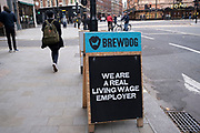 Sign for Brewdog, stating that they are a living wage employer on 1st November 2020 in London, United Kingdom. BrewDog is a Scottish multinational brewery and pub chain.