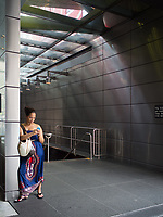 Texting at the 59th street subway entrance on Columbus Circle, New York City