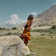 A Girl named Zubaida, watching over the cow herd. The traditional life of the Wakhi people, in the Wakhan corridor, amongst the Pamir mountains.