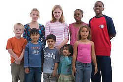 Multiracial group of teenagers and children in the studio,