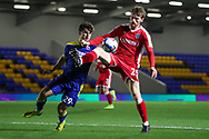 AFC Wimbledon attacker Ryan Longman (29) battles for possession with Gillingham FC defender Robbie Cundy (25) during the EFL Sky Bet League 1 match between AFC Wimbledon and Gillingham at Plough Lane, London, United Kingdom on 23 February 2021.
