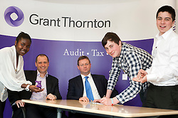 """Grant Thornton Business Awareness Day Chikumo Fiseko of Longley Park 6th form College (right) and Charlie Nixon with James Boreman of Silverdale School (right) make their pitch to The Grant Thornton """"Dragons"""" Jamie Preston senior Tax Manager (seated left) and Paul Houghton Partner (seated right)..http://www.pauldaviddrabble.co.uk.4 April 2012 .Image © Paul David Drabble"""
