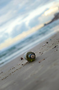 Message in a bottle - a bottle washed up on the sand on a beach