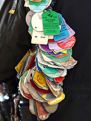 Close up of a racegoers collection of race tags during Gold Cup Day of the 2019 Cheltenham Festival at Cheltenham Racecourse.