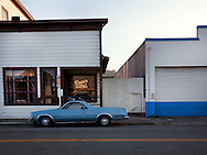 El Camino parked in small town at dusk