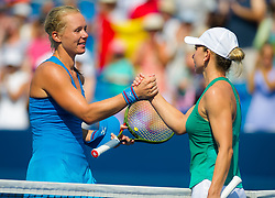 August 19, 2018 - Kiki Bertens of the Netherlands & Simona Halep of Romania shake hands at the net after the final of the 2018 Western & Southern Open WTA Premier 5 tennis tournament. Cincinnati, Ohio, USA. August 19th 2018. (Credit Image: © AFP7 via ZUMA Wire)