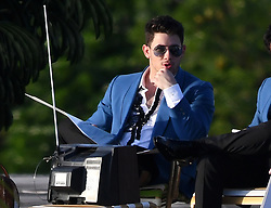 The Jonas Brothers reunite as a band to film a music video in Miami Beach. Joe Jonas, Kevin Jonas, and Nick Jonas were seen filming a music video on the rooftop of the historic International Inn before heading onto a sailboat in Miami Beach, Florida. 24 Mar 2019 Pictured: Joe Jonas; Nick Jonas; Kevin Jonas. Photo credit: MEGA TheMegaAgency.com +1 888 505 6342