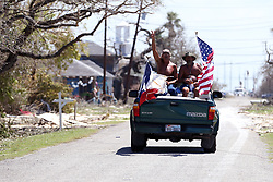 August 29, 2017 - Rockport, Texas, U.S. - With flags flying from the back of their truck, men survey the damage in Rockport, Texas, on Tuesday,  following Hurricane Harvey. (Credit Image: © Rachel Denny Clow/TNS via ZUMA Wire)