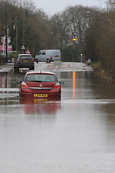 © Licensed to London News Pictures. 24/12/2013<br /> London Road A224  Polhill in Halstead, Kent is closed with cars abandoned in 4 feet of rain water overnight.<br /> The UK  has woken up to trees and electricity cables down following a night of gale-force winds and torrential rain.<br /> Photo credit :Grant Falvey/LNP