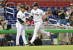 May 31, 2017 - Miami, FL, USA - Miami Marlins third base coach Fredi Gonzalez, left, greets Justin Bour after his solo home run in the fifth inning against the Philadelphia Phillies on Wednesday, May 31, 2017 at Marlins Park in Little Havana in Miami. The Marlins won, 10-2. (Credit Image: © Pedro Portal/TNS via ZUMA Wire)