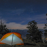 A tent in the Ancient Bristlecone Pine Forest of California's White Mountains overlooks the town of Bishop and the Palisade region of the eastern Sierra Nevada.