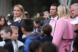 WASHINGTON, DC - APRIL 02: (AFP OUT) Vanessa Trump (L), Donald Trump Jr. and Tiffany Trump attend the 140th annual Easter Egg Roll on the South Lawn of the White House April 2, 2018 in Washington, DC. The White House said they are expecting 30,000 children and adults to participate in the annual tradition of rolling colored eggs down the White House lawn that was started by President Rutherford B. Hayes in 1878. (Photo by Chip Somodevilla/Getty Images)