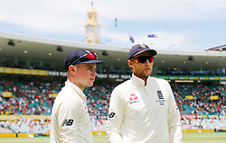 England's Joe Root talks with Mason Crane during day two of the Ashes Test match at Sydney Cricket Ground.