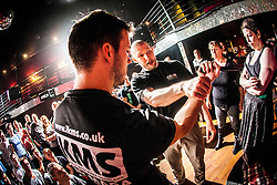 Tommy Blom demonstrates to the students a knife defence exercise. IKMS 'In The Club' seminar with KMG Global Team Instructor and Expert Level 5, Tommy Blom, at the Buff Club in Glasgow's City Centre. Bringing Krav Maga training out with the confines of the gym into a real nightclub/bar.<br /> © Michael Schofield.
