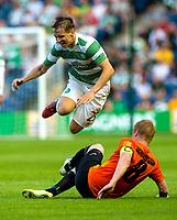 22/07/14 UEFA CHAMPIONS LEAGUE 2ND QUALIFYING ROUND 2ND LEG<br /> CELTIC v KR REYKJAVIK<br /> BT MURRAYFIELD STADIUM - EDINBURGH<br /> Celtic ace Stefan Johansen (left) is upended by Baldur Sigurdsson