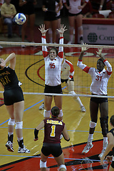 31 Aug 2010: Melissa Hastings strikes the ball in the direction of Kristin Stauter and Hailey Kelley. The Illinois State Redbirds trumped the Rambles of Loyola-Chicago 3 sets to none at Redbird Arena on the campus of Illinois State University in Normal Illinois.