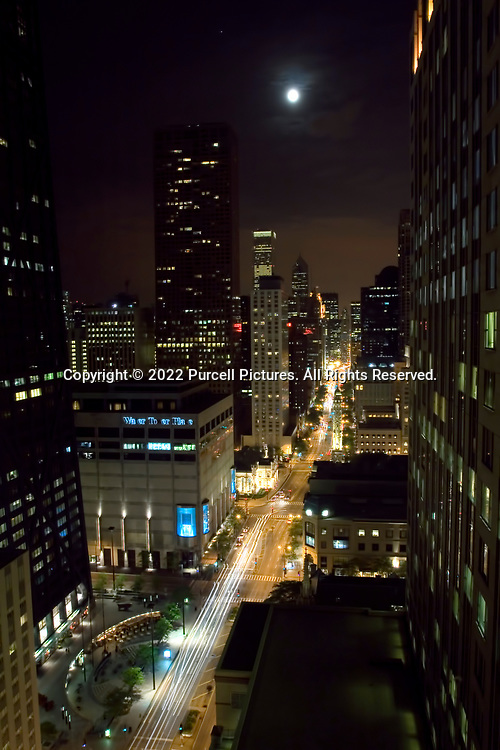 Looking south on North Michigan Avenue in Chicago down on traffic on a moonlight night