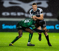 Tom Williams of Ospreys is tackled by Niyi Adeolokun of Connacht<br /> <br /> Photographer Simon King/Replay Images<br /> <br /> Guinness PRO14 Round 6 - Ospreys v Connacht - Saturday 2nd November 2019 - Liberty Stadium - Swansea<br /> <br /> World Copyright © Replay Images . All rights reserved. info@replayimages.co.uk - http://replayimages.co.uk