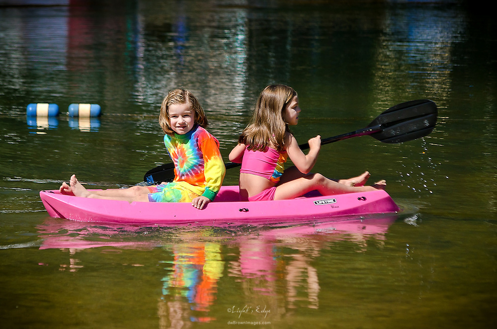 Two girls explore the shallows of the pond at The Old Cedar Campground early in the day during the 2012 late summer Camp Jam In The Pines in Monroeville, NJ.