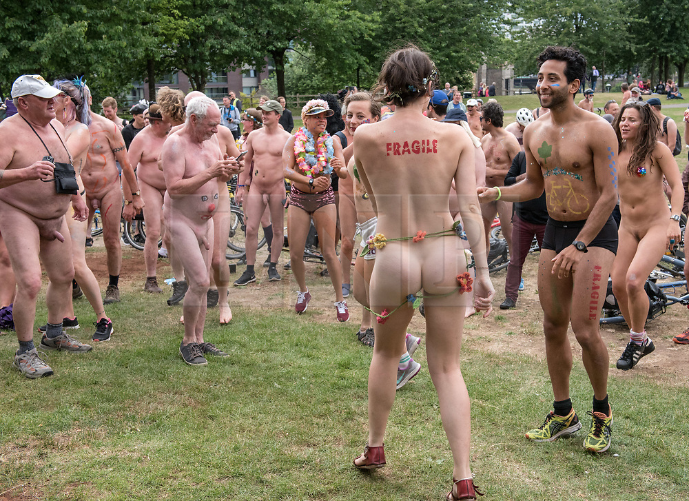 """© Licensed to London News Pictures.  <br /> 17/06/2018; Bristol, UK. The World Naked Bike Ride through Bristol city centre, including a stop to dance to in the park. The event sees hundreds of naked and near naked cyclists cycle around Bristol city centre to campaign for improved cycle routes in Bristol and to raise awareness of the dangers and vulnerability cyclists in the city face on a daily basis. The event included a symbolic """"die-in"""" to commemorate the 23 cyclists that have been killed on Bristol's roads. Photo credit: Simon Chapman/LNP"""