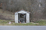 A damaged religious shrine on the way to Visso.