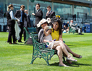 © Licensed to London News Pictures. 17/06/2014. Ascot, UK. Women take a selfie.  Day one at Royal Ascot 17th June 2014. Royal Ascot has established itself as a national institution and the centrepiece of the British social calendar as well as being a stage for the best racehorses in the world. Photo credit : Stephen Simpson/LNP