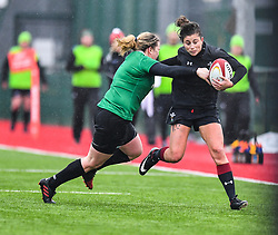 Wales women's Jessica Kavanagh-Williams evades the tackle of Ireland women's Niamh Briggs<br /> <br /> Photographer Craig Thomas/Replay Images<br /> <br /> International Friendly - Wales women v Ireland women - Sunday 21th January 2018 - CCB Centre for Sporting Excellence - Ystrad Mynach<br /> <br /> World Copyright © Replay Images . All rights reserved. info@replayimages.co.uk - http://replayimages.co.uk