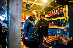 © Licensed to London News Pictures. 23/01/2016. Calais, France. Leader of the Labour Party JEREMY CORBYN talks to a shop worker during a visit to the camp known as the 'Jungle' in Calais, France, where thousands of migrants and refugees attempting to reach the UK are currently living. Photo credit: Ben Cawthra/LNP